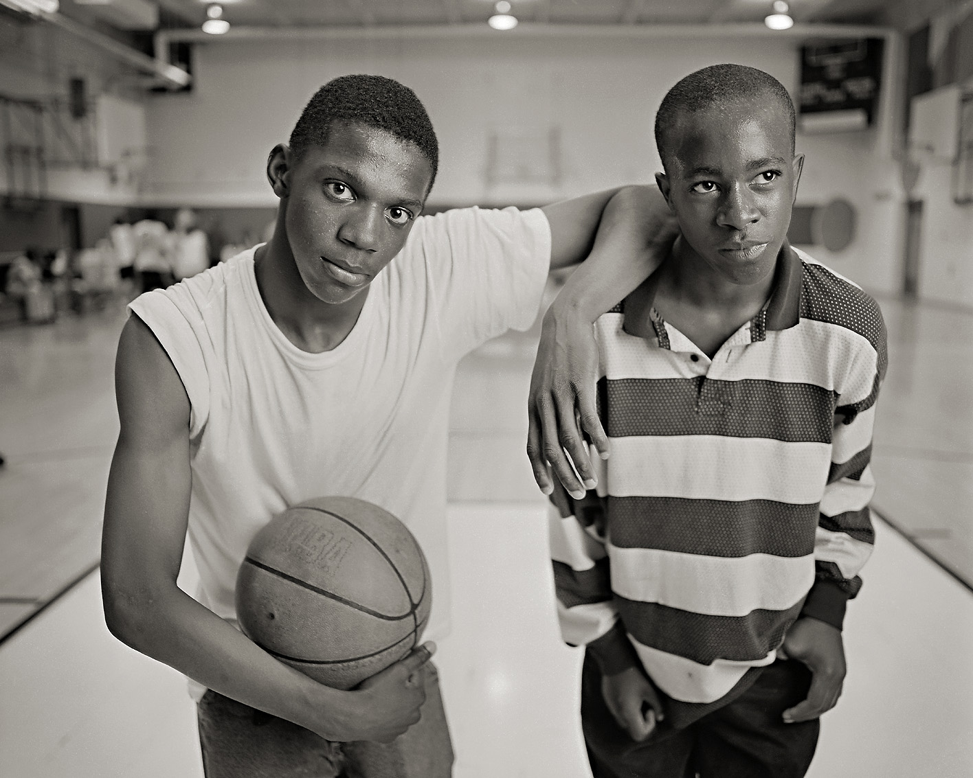 Basketball players black and white portrait in a gym.