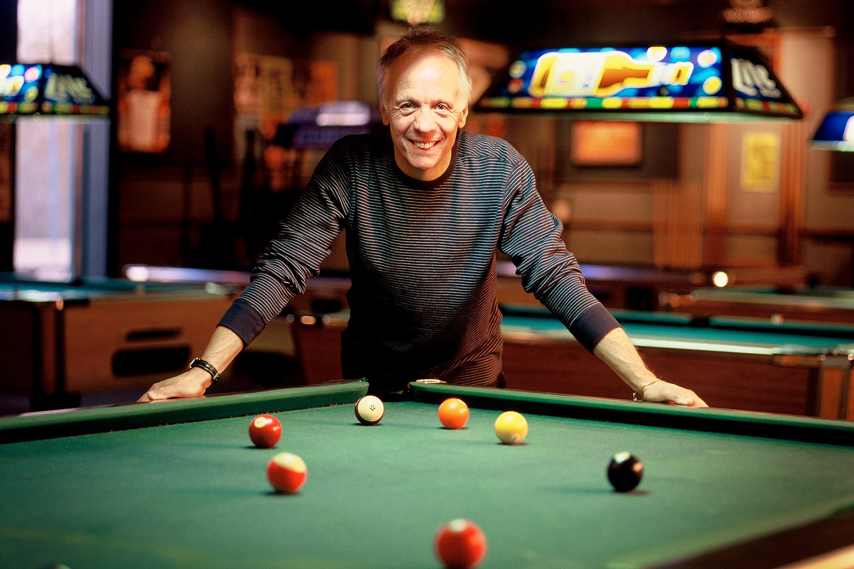 Musician Robin Trower with pool table.