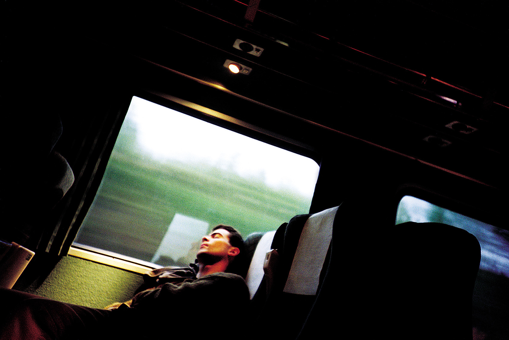 Sleepy commuter on Talgo Train from Seattle to Portland.